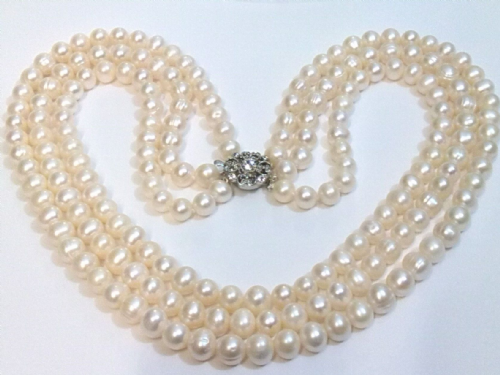 Triple Stranded necklace of large white pearls